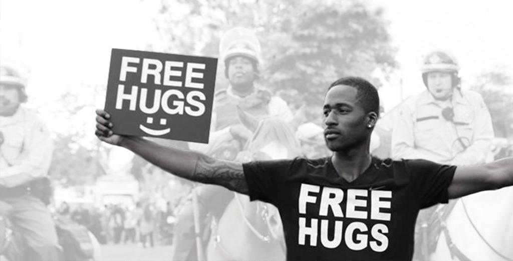 Activist promotes peace with free hugs movement